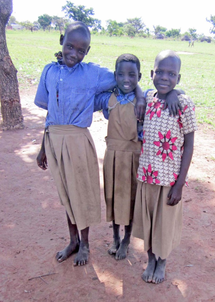 Sponsored child, Betty, is happy to be at school with her friends.