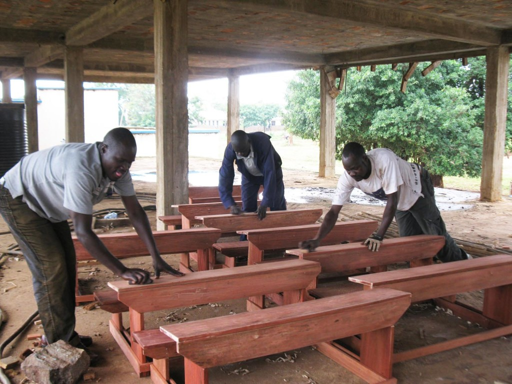 Uganda carpenters building school desks