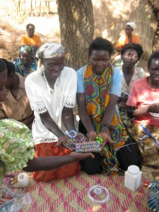 Agwata women showing their paper bead jewelry creations