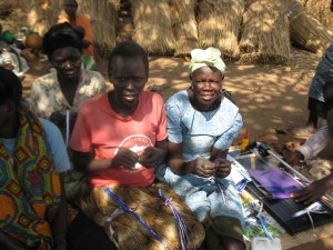 Agwata ladies demonstrating making paper beads