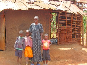 Ayaa Rose and children in their slum home.