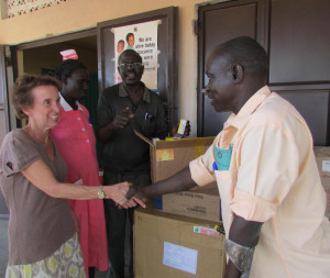 Outreach Uganda presents needed drugs to clinic.