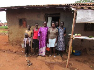 Nekolina with her family at her home and grocery kiosk