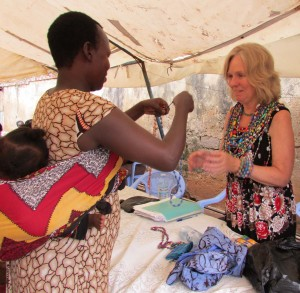 Outreach Uganda volunteer receiving farewell gifts from her Uganda women students.