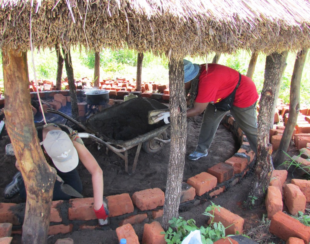 Volunteers building hut wall.