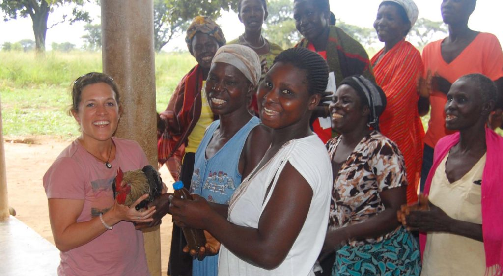 Agwata women's group presents Leah with a gift of two chickens when she first arrived.