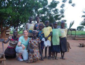 Uganda volunteer Leah with her sponsored child