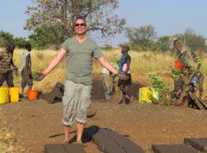 Uganda Volunteer making earthen bricks for the school.