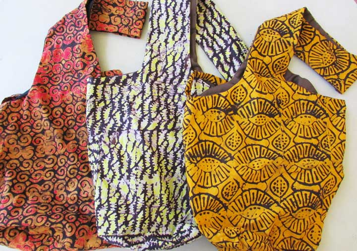 Sling bag - batiks in oranges and yellows